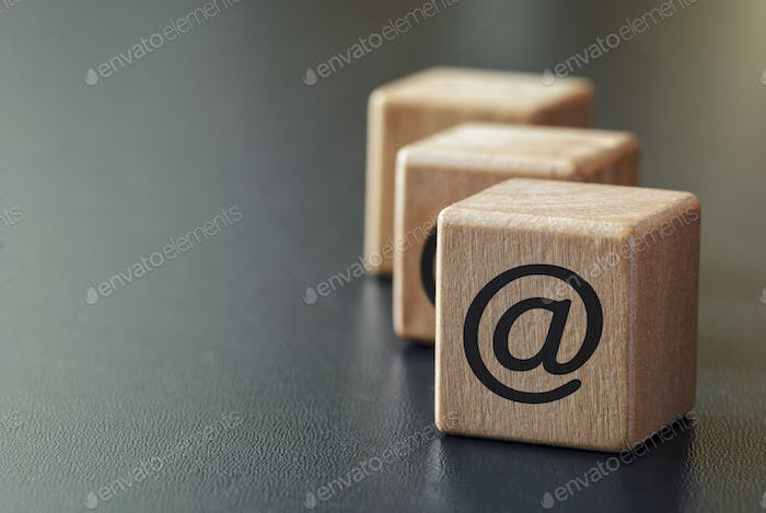 Wooden dices with internet at symbol