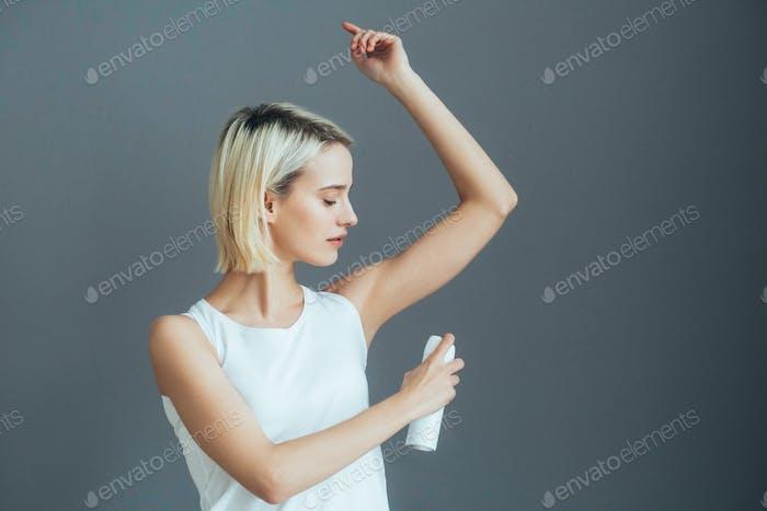 Deodorant spray woman portrait
