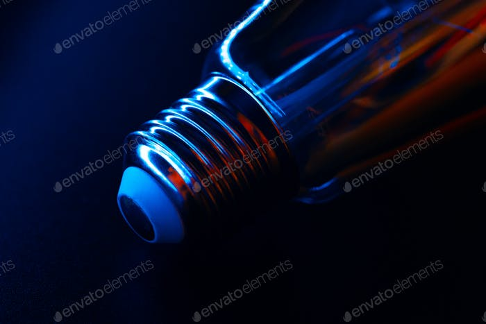 Light bulb on black background close up