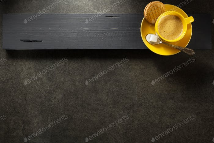 cup of coffee on wood