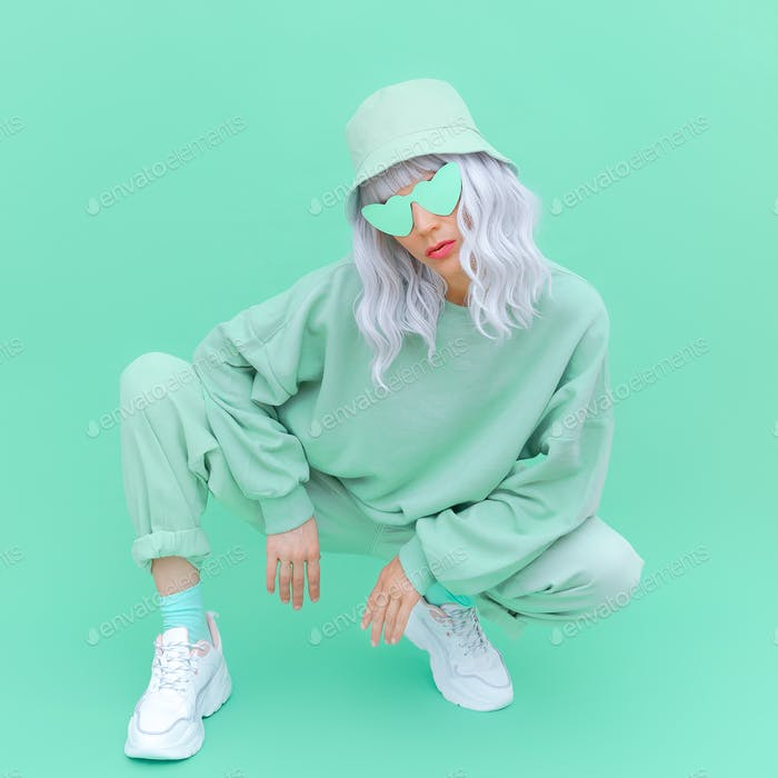 Fresh Mint urban look. Fashion Girl 90s. Monochrome color trends. Aqua Menthe aesthetic concept