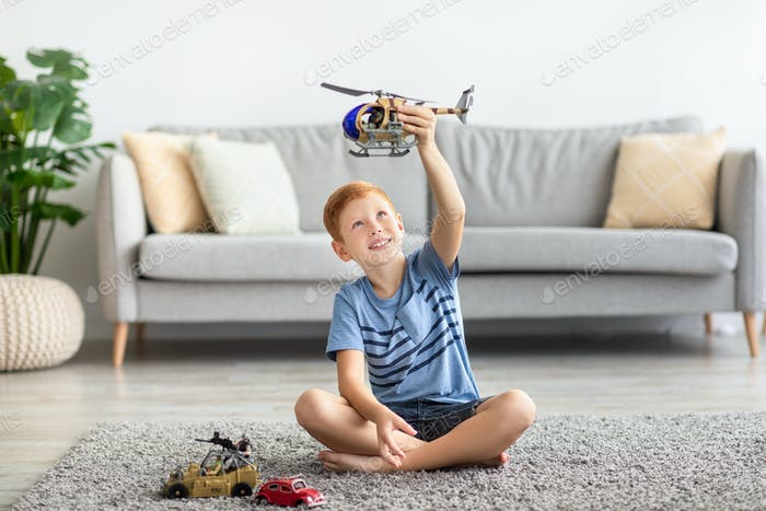 Child playing with toys alone at home