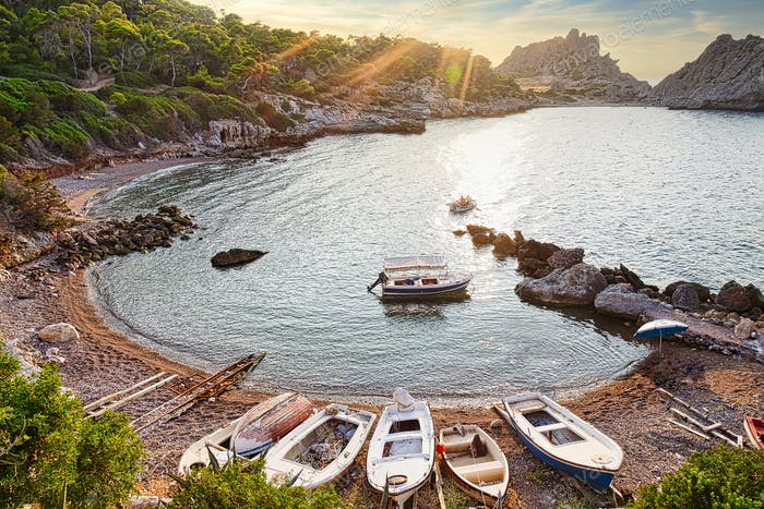Small speed boats in wild bay of Mediterranean sea, Greece