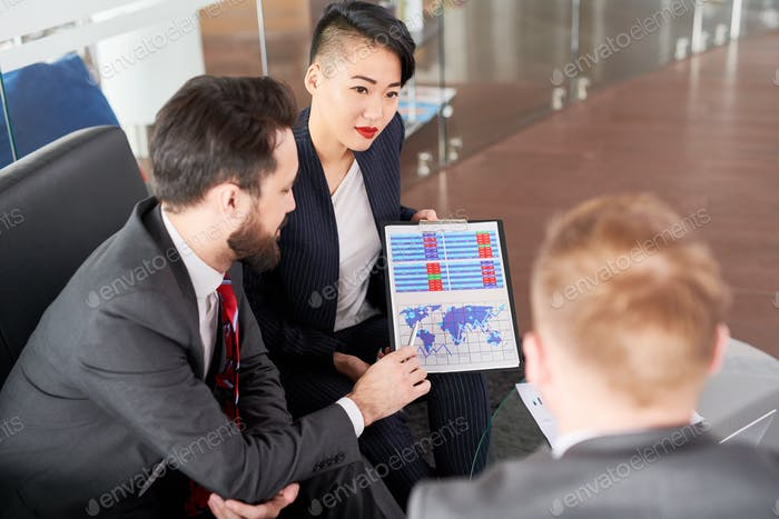 Group of Managers Studying Statistics