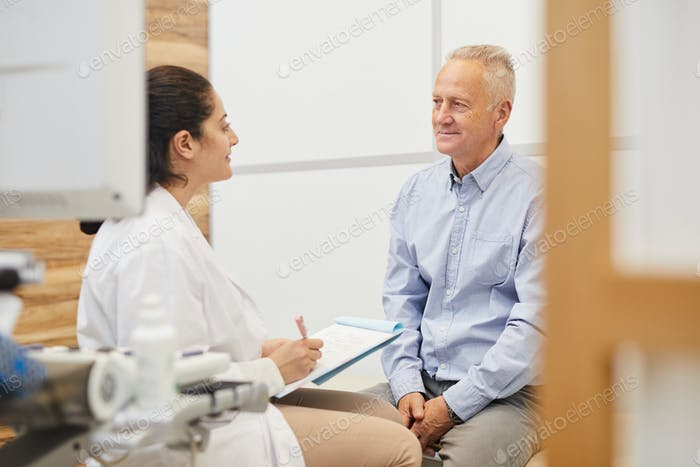 Middle-Eastern Doctor Checking Senior Patient