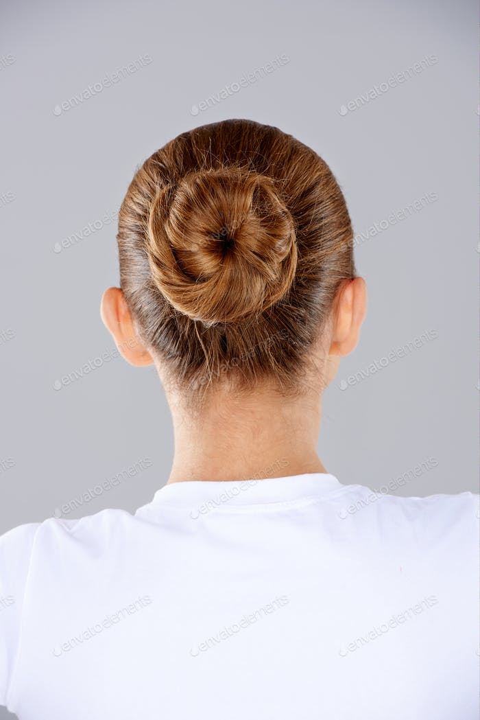 Brunette hair in a neat bun