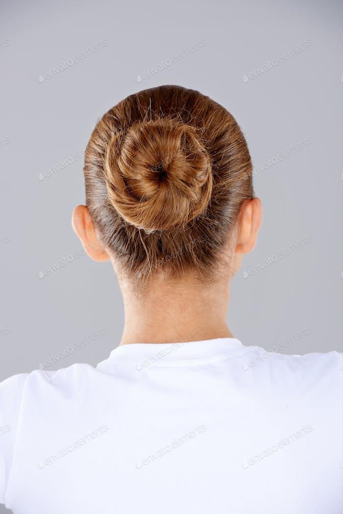 Brunette hair in a neat bun