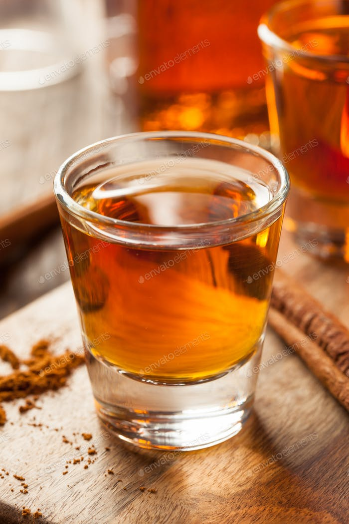 Cinnamon Whiskey Bourbon in a Shot Glass