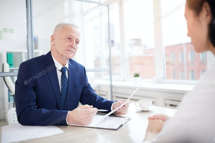 Senior Man Interviewing Job Candidate