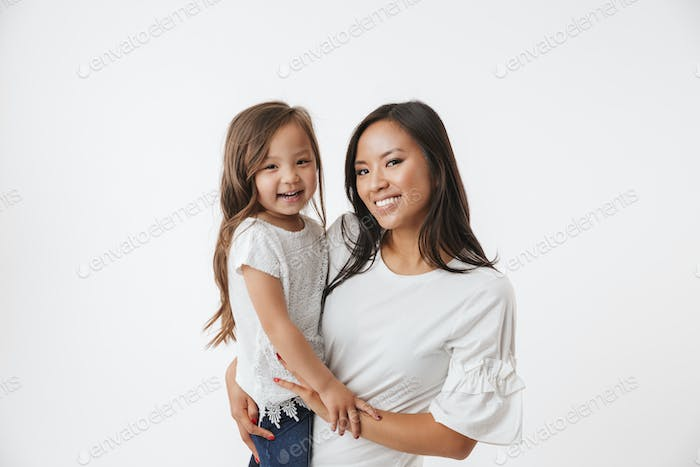 Happy young asian woman mother with her little daughter