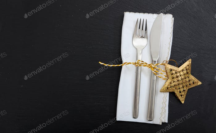 Christmas place setting on black background
