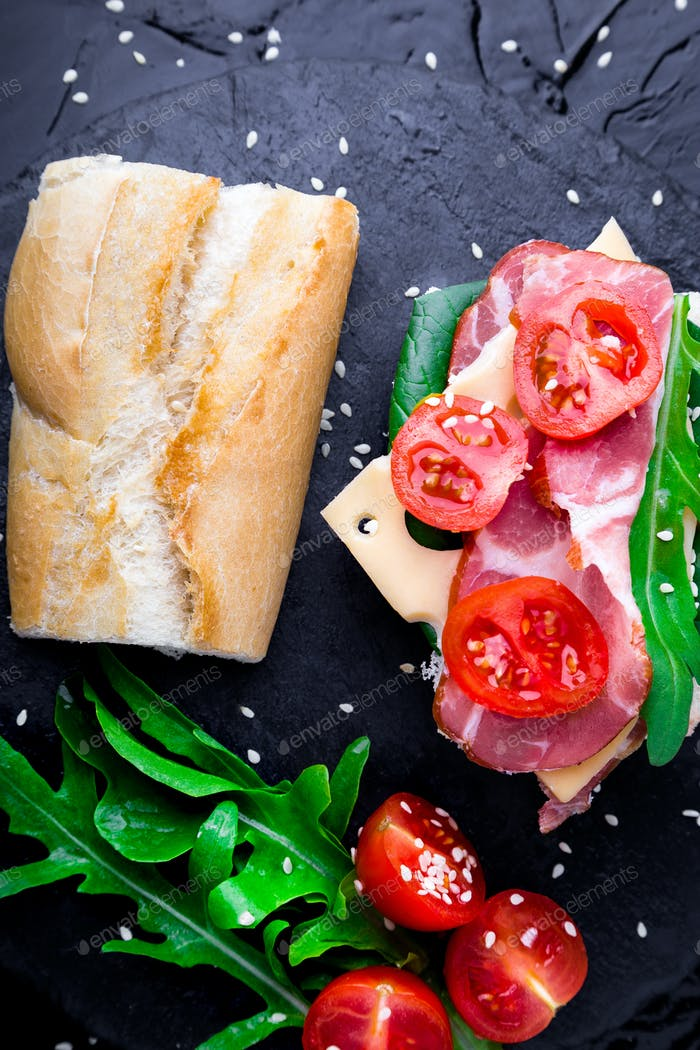 Open sandwich with jamon, arugula, tomatoes,