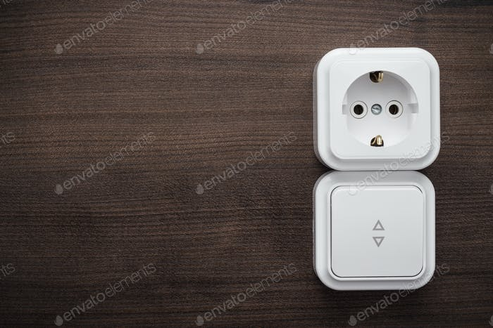 Switch And Outlet On The Wall