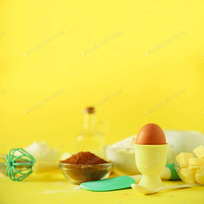 Bakery food frame, cooking concept. Different baking ingredients - butter, sugar, flour, milk, eggs