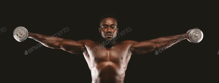 African american athlete doing dumbbell lateral raise