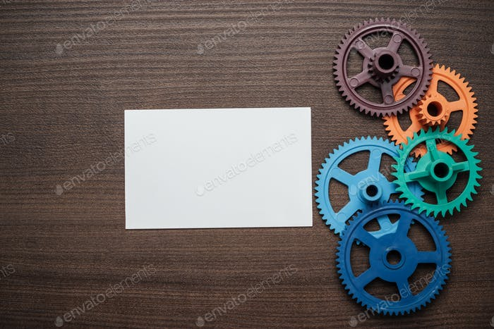 Colorful Gears On The Brown Wooden Background