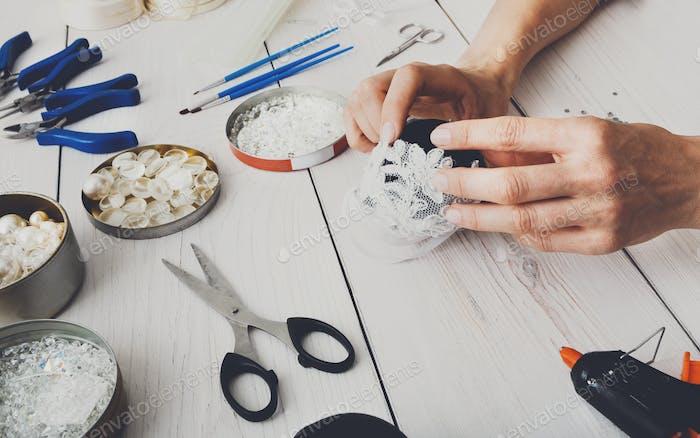 Creative diy craft hobby. Handmade christmas decoration, balls and garland