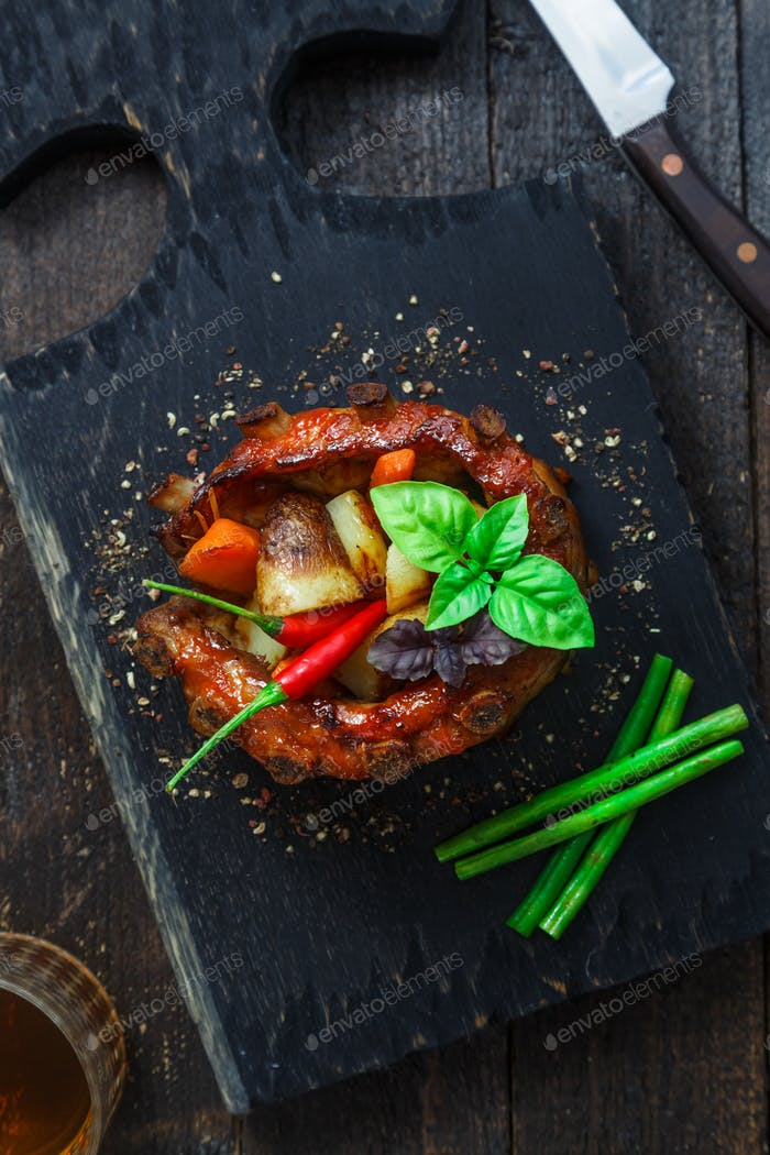 Crown roast of pork with grilled vegetables and whiskey sauce