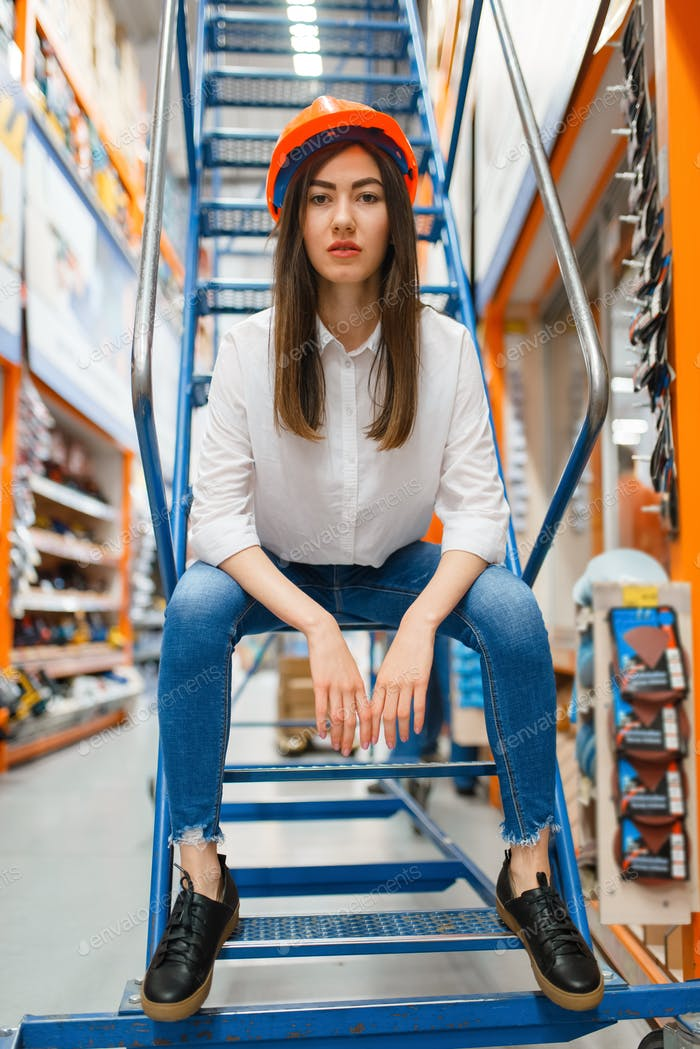 Female customer sitting on stairs, hardware store