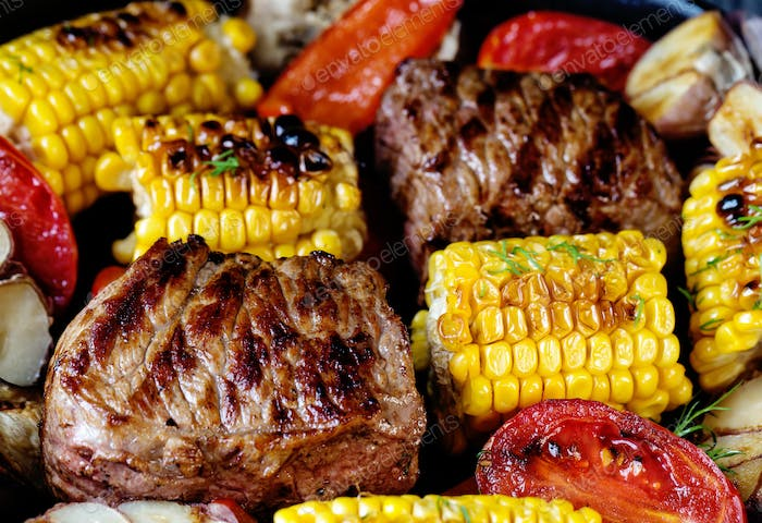 Food background of baked meat and corn