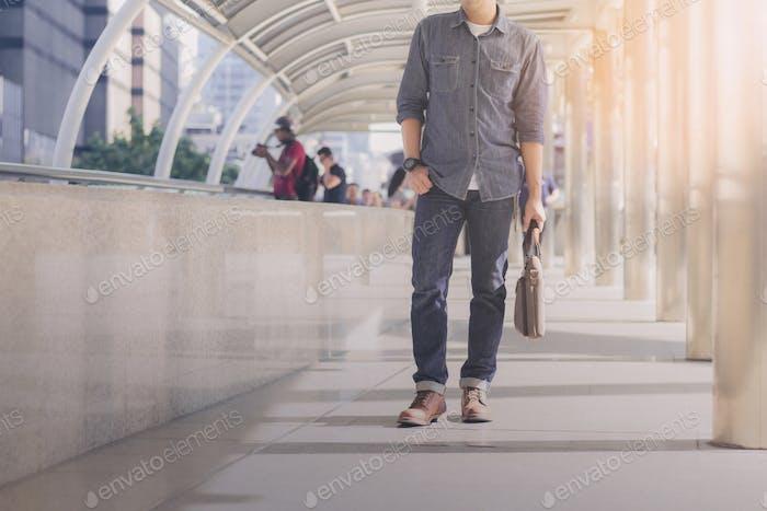 Male walking in city