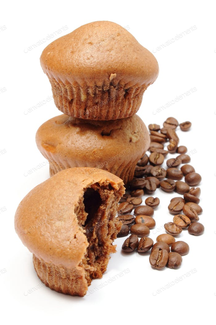 Fresh baked muffins and coffee grains on white background