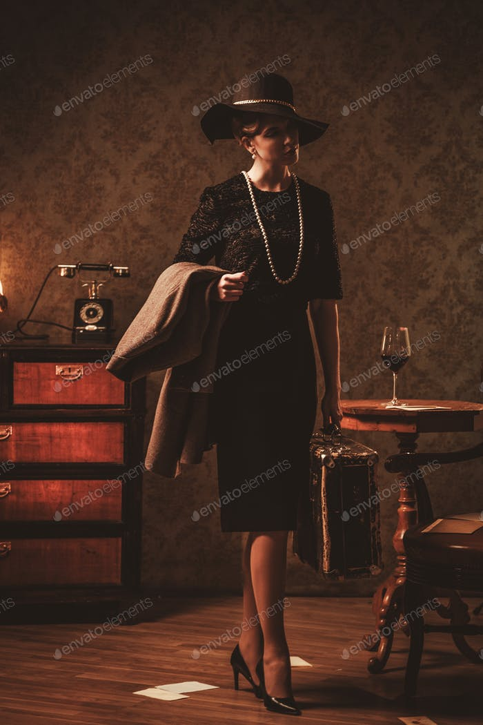 Beautiful woman with suitcase in retro interior