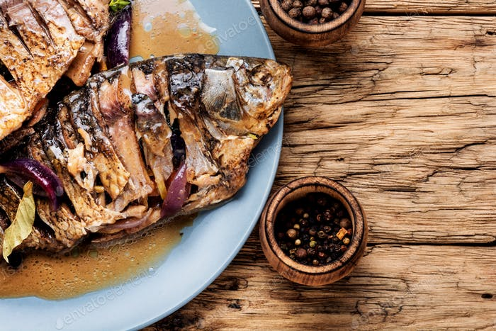 Grilled fish on plate