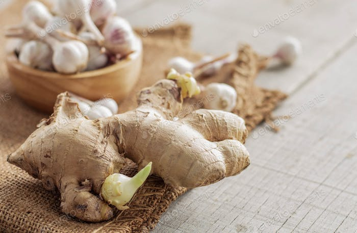 ginger and garlic on wooden