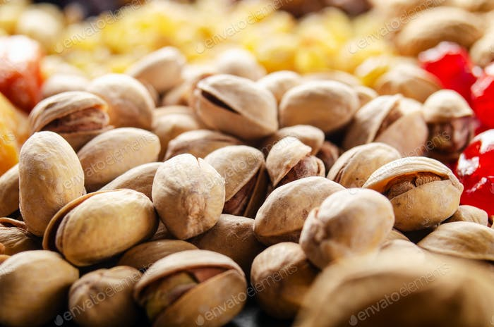 Closeup view at pistachio nuts on kitchen table. Vegetarian food concept
