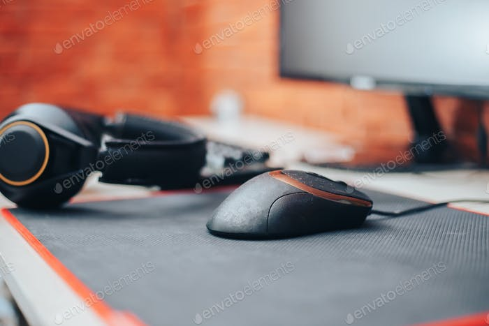 Gaming arena background with mouse gear headphones computer, focuse on mouse selected focuse