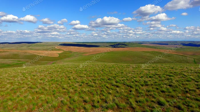 Rolling Green Hills Agricultural Land Partly Cloudy Blue Sky