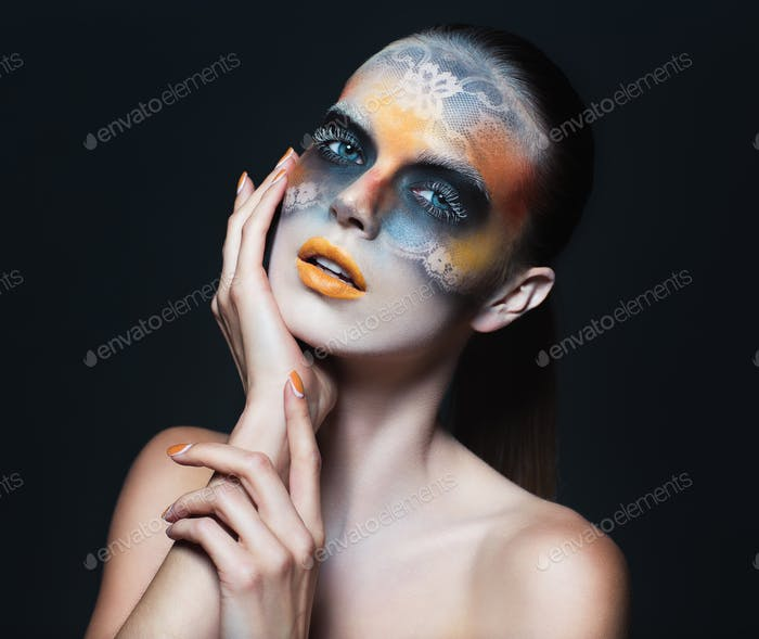 Portrait of beautiful glamor girl with dark eye make-up in the f