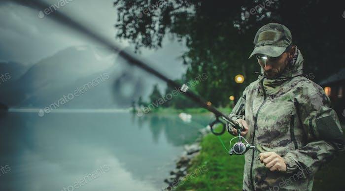 Men Preparing Rod For Late Evening Fishing