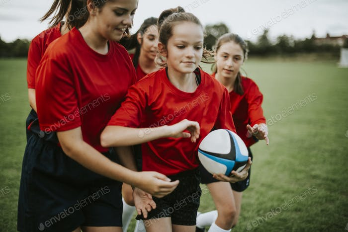 Female rugby players in action on the field