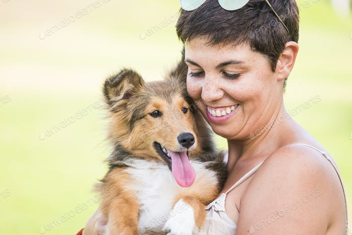 Beautiful portrait of young caucasian woman and pet