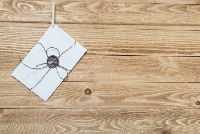 Mail envelope on rope