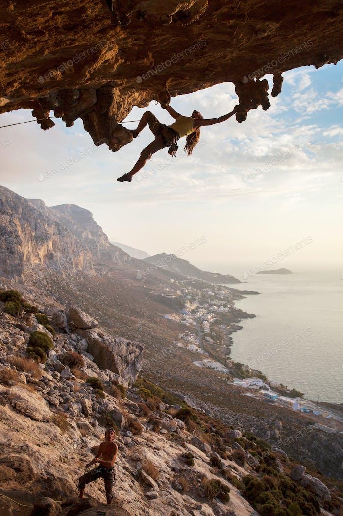 Rock climber at sunset, Kalymnos, Greece