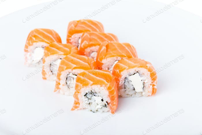 Delicious salmon sushi roll with mayonnaise.