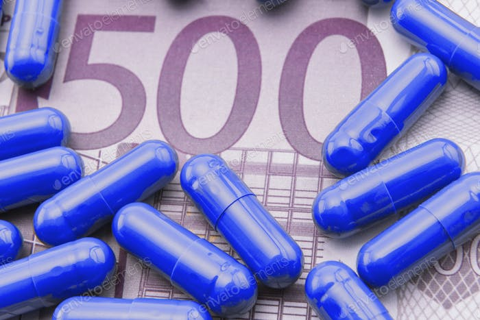 Blue capsules up ticket of 500 euros, concept of health copay