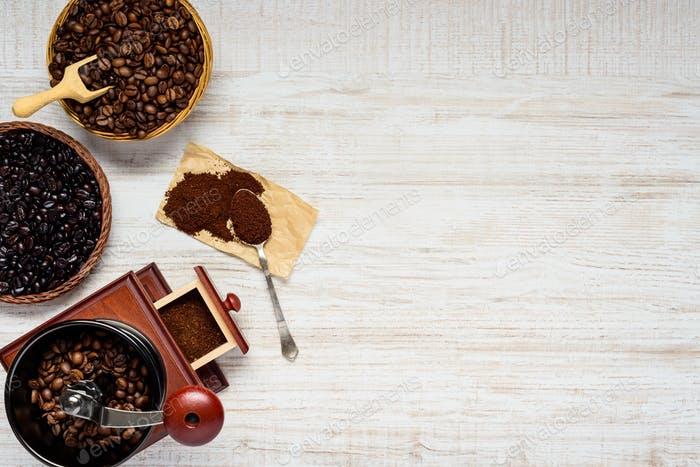 Dark and Brown Coffee Beans with Grinder on Copy Space