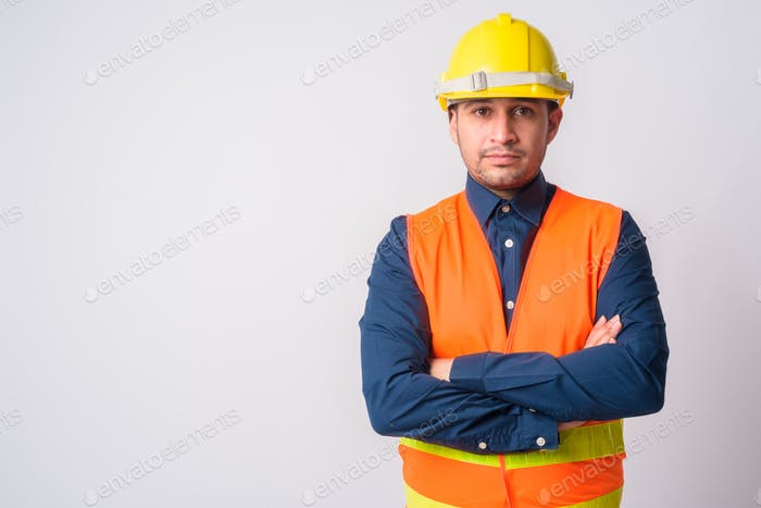 Portrait of young Persian man construction worker with arms crossed