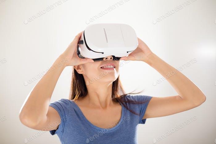 Asian woman using virtual reality device