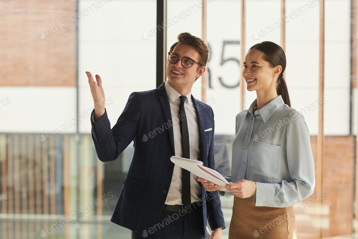 Real Estate Agent Showing Commercial Property