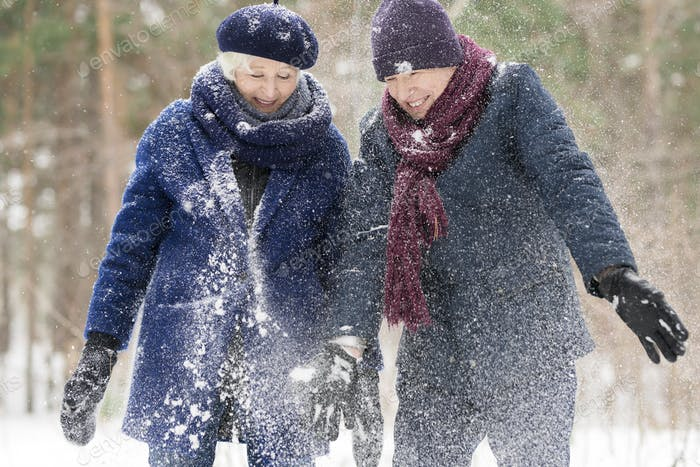 Senior Couple Covered in Snow