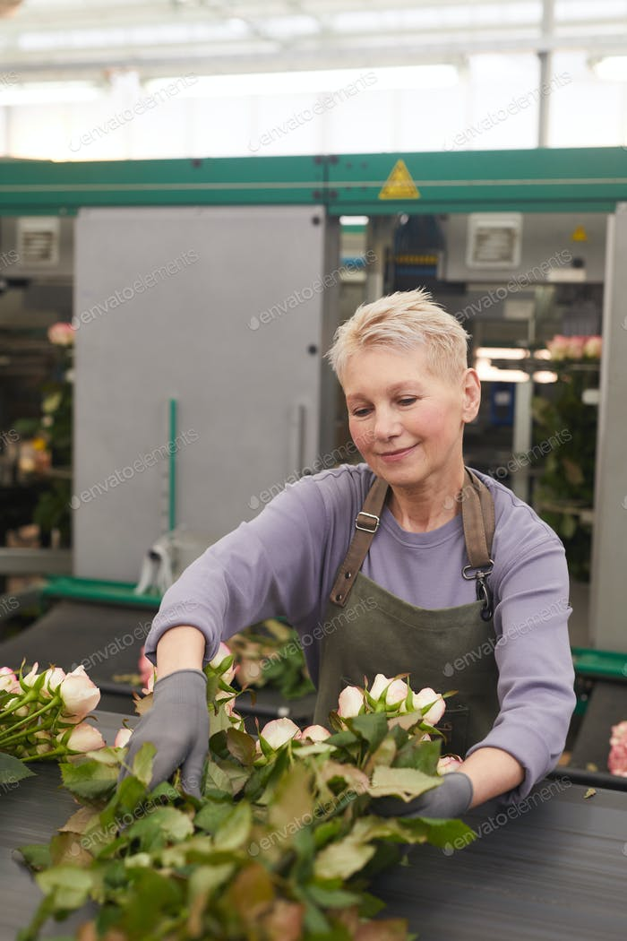 Gardener sorting flowers