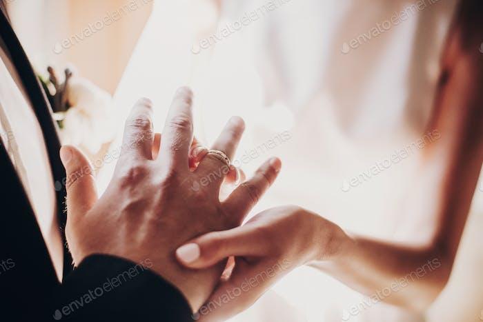 Wedding couple exchanging wedding rings