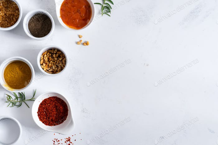 Set of different spices for sauces on stone background