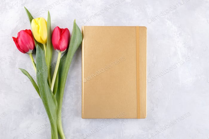 Notepad mock up and tulips