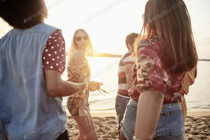 Young people dancing on the beach